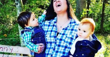 mom holding toddler twins in arms hot mess mom