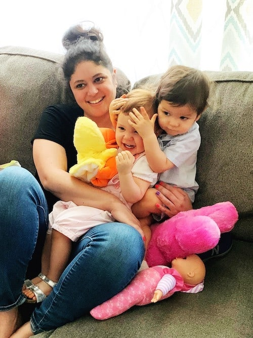 mom on couch holding toddler twins hot mess mom