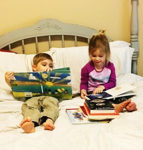 three year old twins reading books in bed kids to read