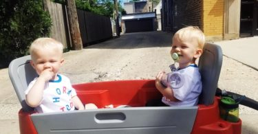 twin toddler boys sitting in a wagon toys that twins can share