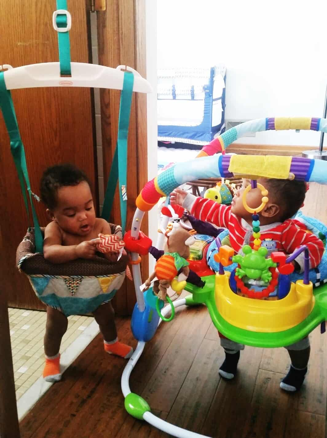 twin babies in jumparoo and exersaucer gift for newborn twins