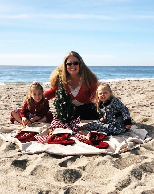 mom and twin girls on the beach christmas eve new traditions