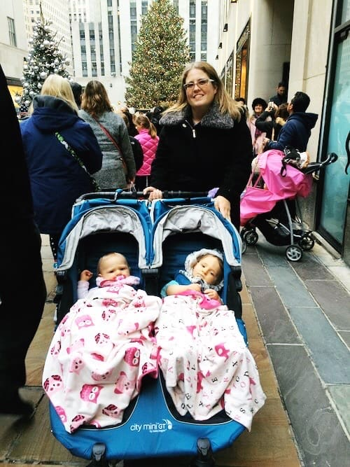 mom and twins in stroller at rockefeller center christmas tree nyc new traditions