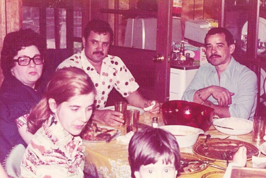 old photo of 1970s family at holiday dinner table new traditions