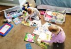 two girls playing in their room with quiet time boxes