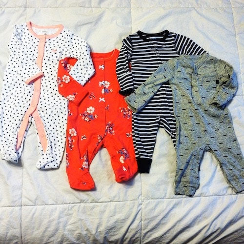 baby clothing on a bed Twins Sexes a Surprise