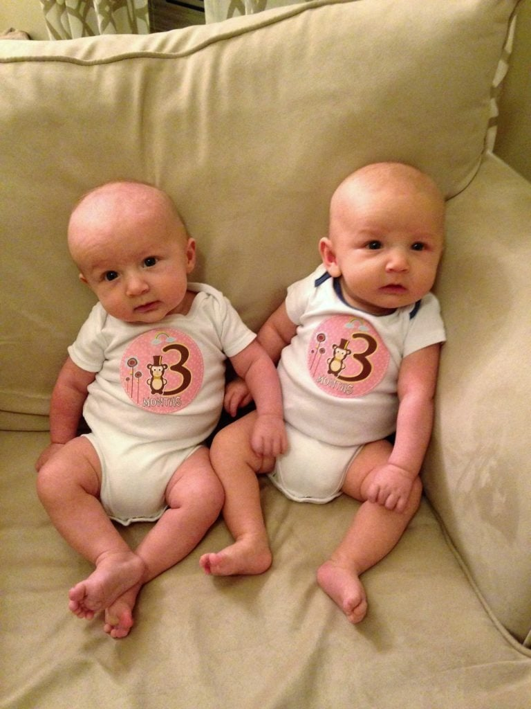 infant twins sitting on a couch mother-in-law taught