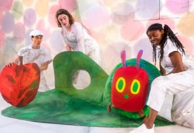 3 actors posing with puppet caterpillar the very hungry caterpillar show