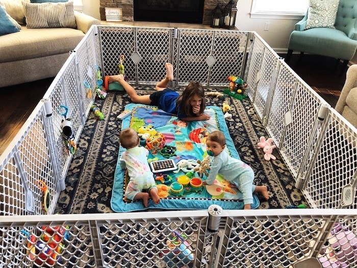 baby twins and older sister in a play yard Container Baby Syndrome