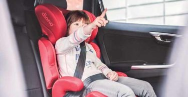 Child in red carseat