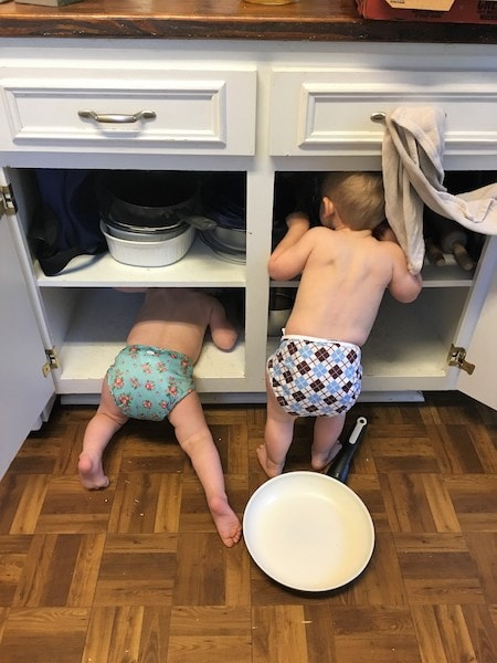 toddler twins looking through kitchen cabinets Keep Twins Busy