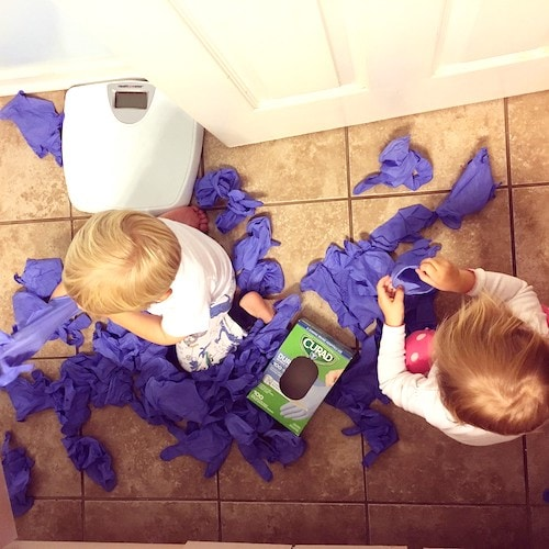 toddler twins pulling rubber gloves out of a box Keep Twins Busy