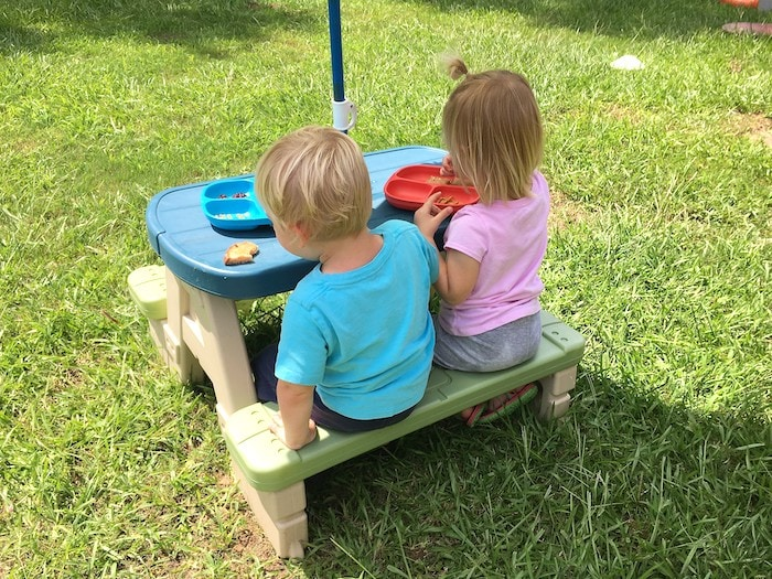 toddler twins sitting at picnic table Keep Twins Busy