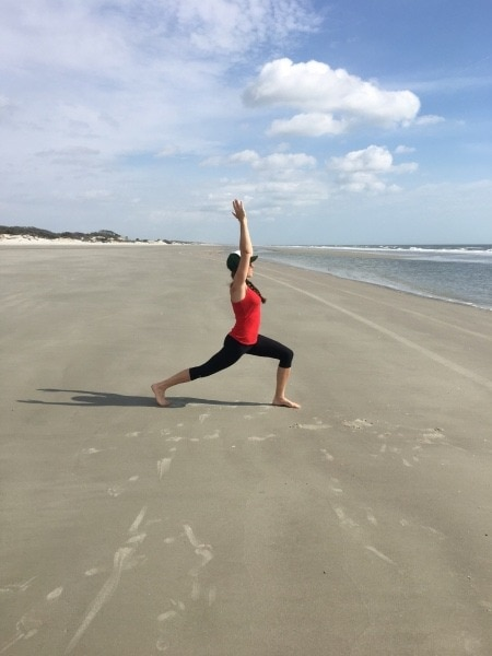 woman doing yoga on beach mindfulness