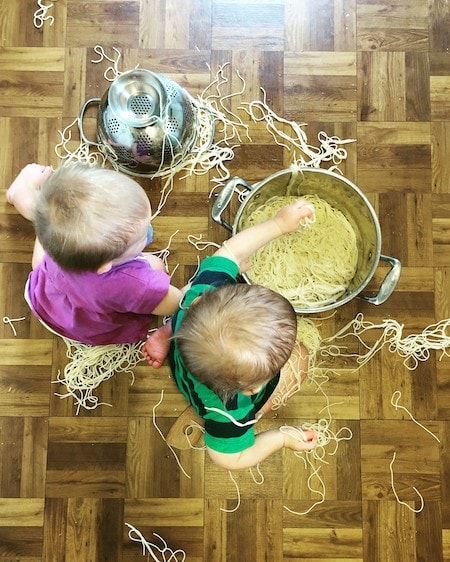 toddler twins playing with pasta on the floor 11 Twin Mom Observations