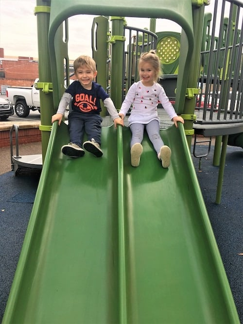 twin kids playing on the slide twins your excuse