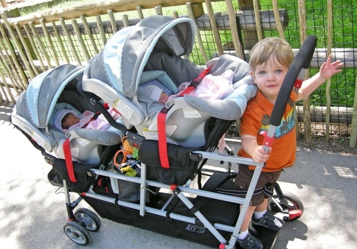twins and toddler in double snap n go stroller reproductive assistance