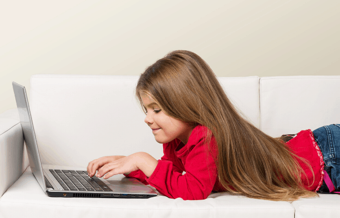 free educational resources girl on couch with laptop