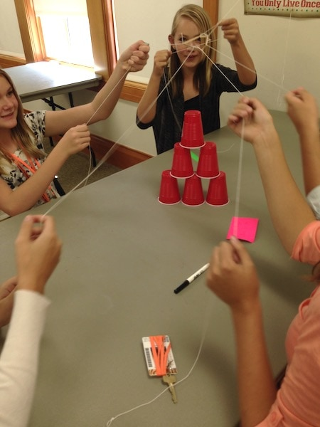 kids playing with strings and cups love of math