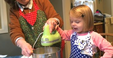 little girl cooking with grandma love of math