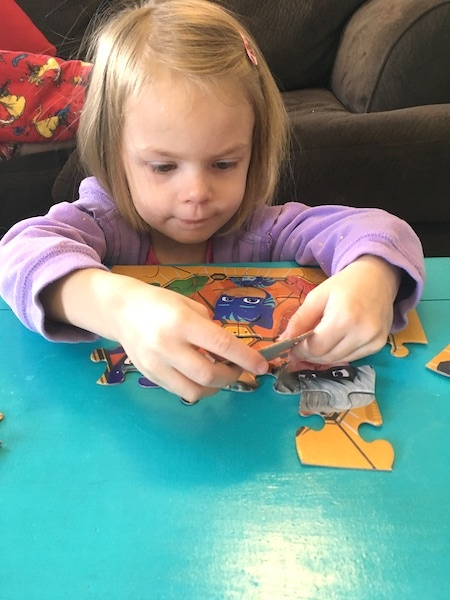 girl doing a puzzle love of math