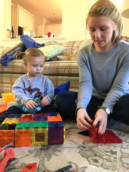 mom and child playing with magnatiles love of math