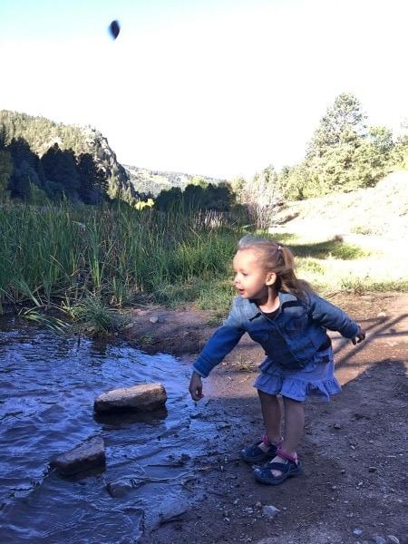 girl skipping rocks preschool schedule
