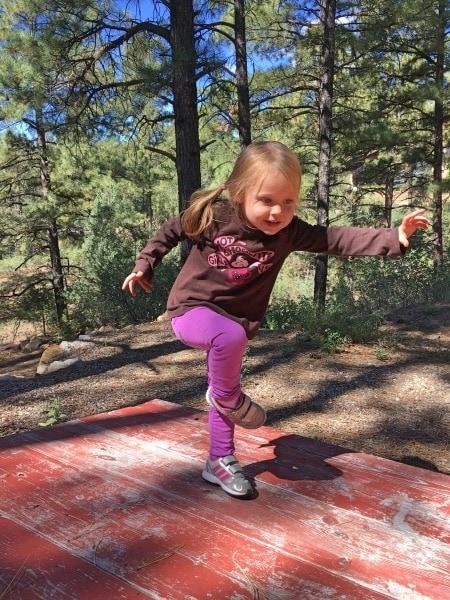 girl standing on bench preschool schedule