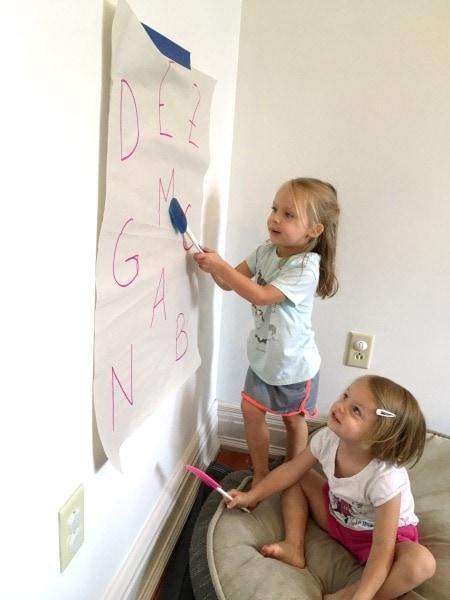 twin girls drawing on wall paper preschool schedule