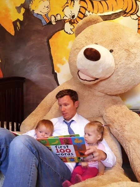 dad reading to twin toddlers teachable moments