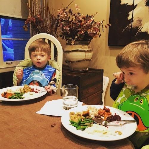 twin toddler boys eating thanksgiving dinner