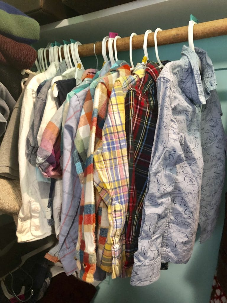 closet of kids clothes dressing multiples