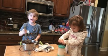 two little kids cooking
