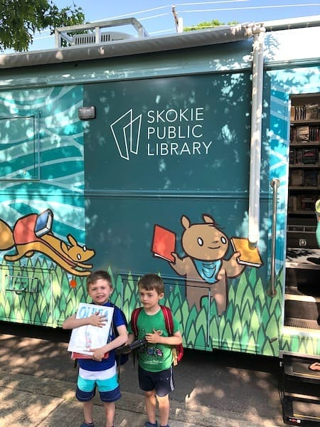 kids in front of bookmobile learning over summer break