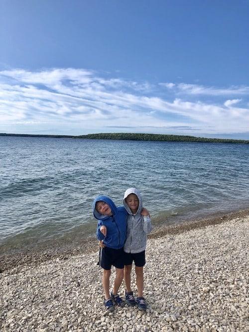 two boys on beach mackinac island lodging