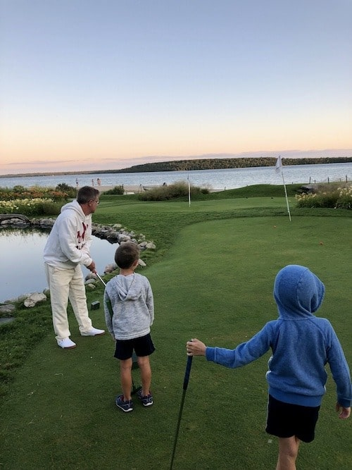 family playing mini golf mackinac island lodging