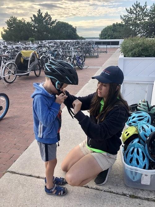 boy putting on bike helmet mackinac island lodging