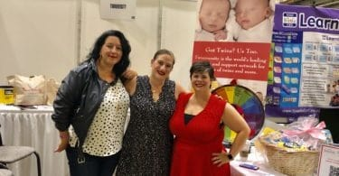natalie jen and julie at Twiniversity booth at chicago baby show