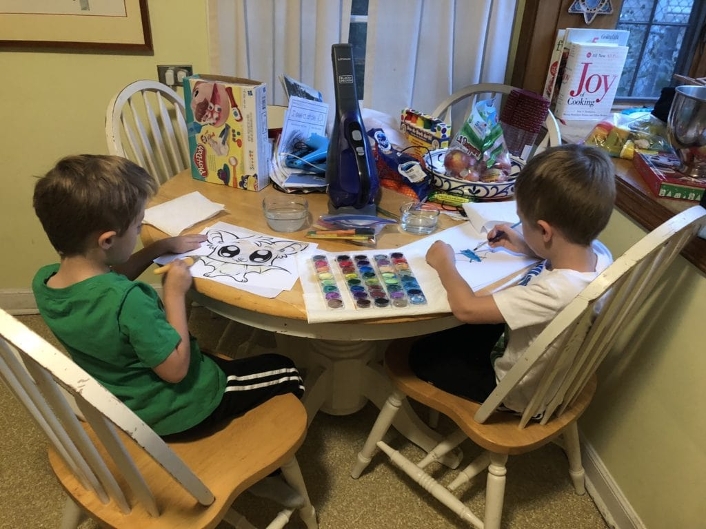 kids painting at a table after school messes