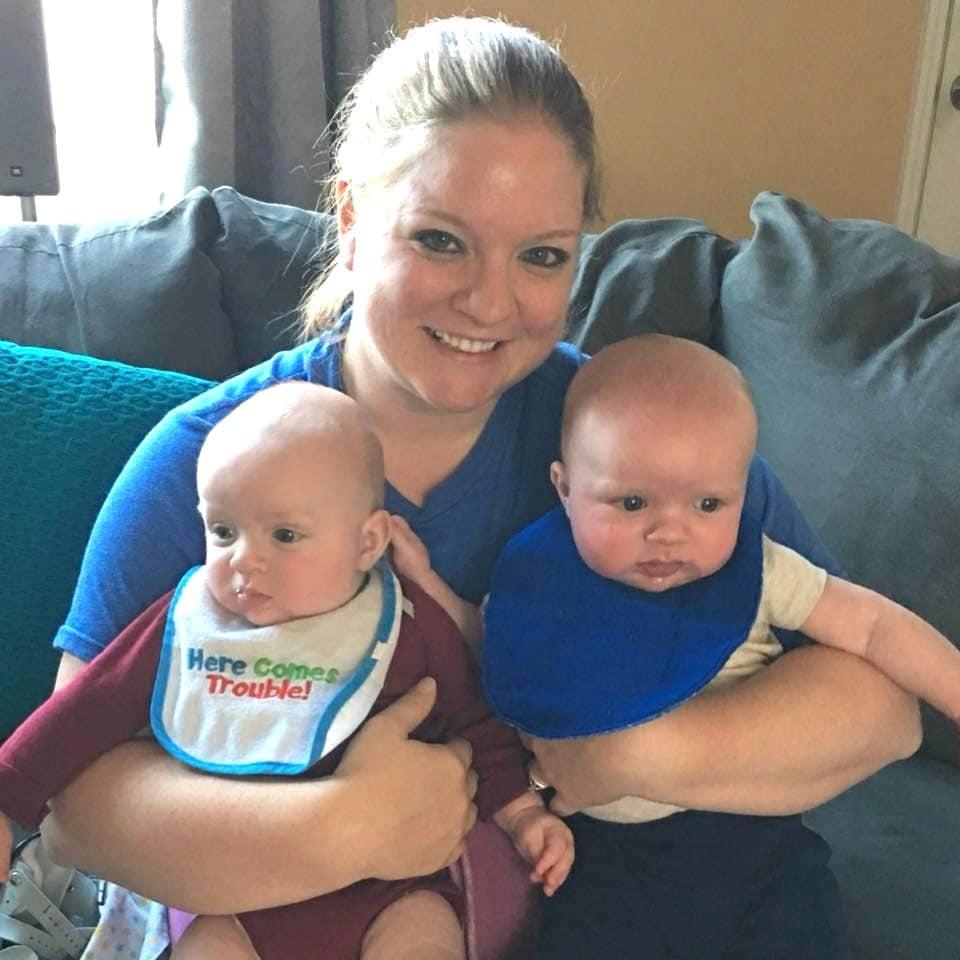 mom holding twin babies bonding with my newborn twins