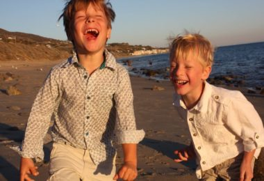 advocate for my kids twin boys laughing on the beach
