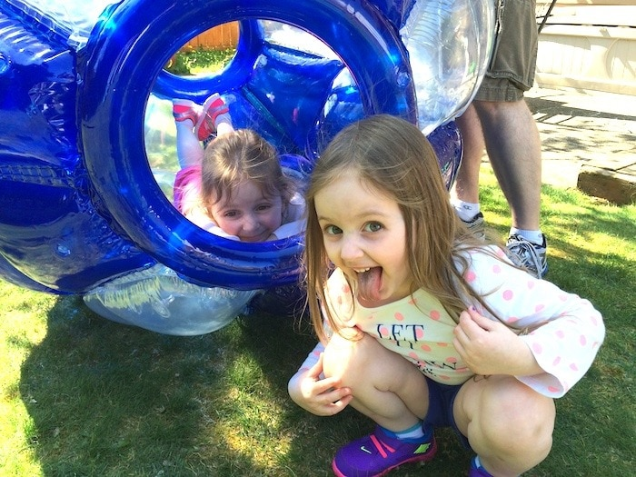 twin girls in backyard three-year-old twins