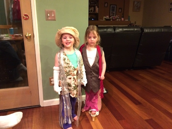 twin girls dressing up three-year-old twins