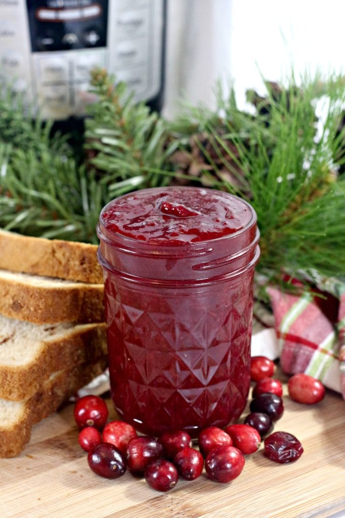 jar of cranberry jelly on a table