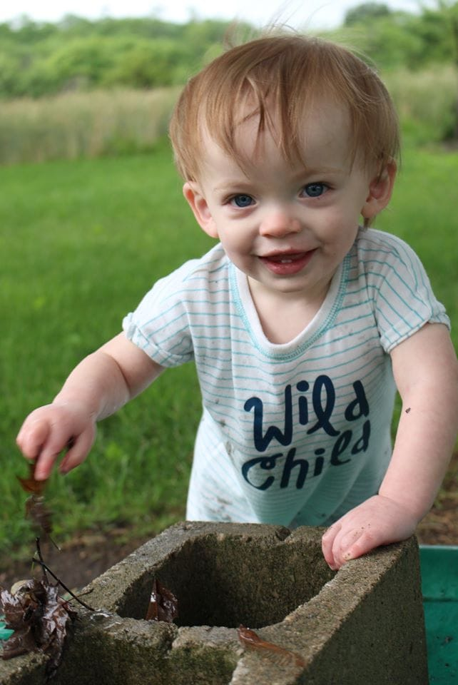 toddler boy in backyard why are you covered in poop