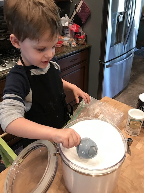 boy scooping flour kids cooking