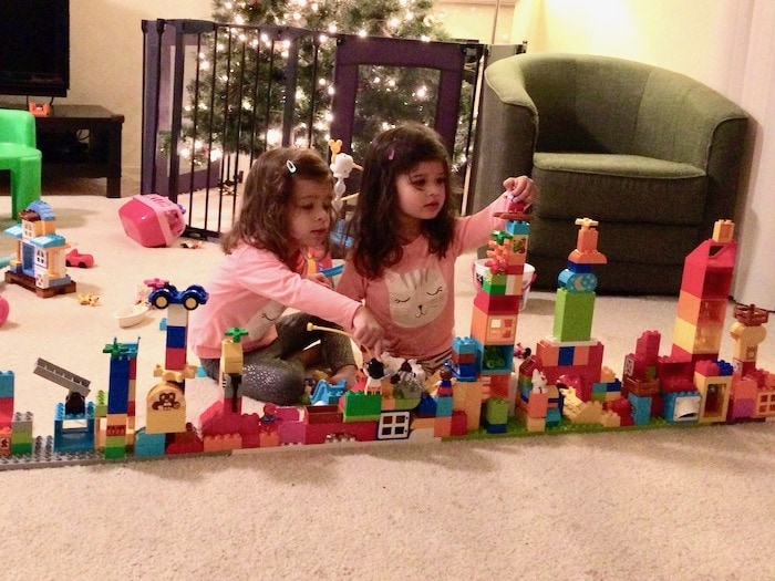 twin girls building with blocks Sharing Between Twins