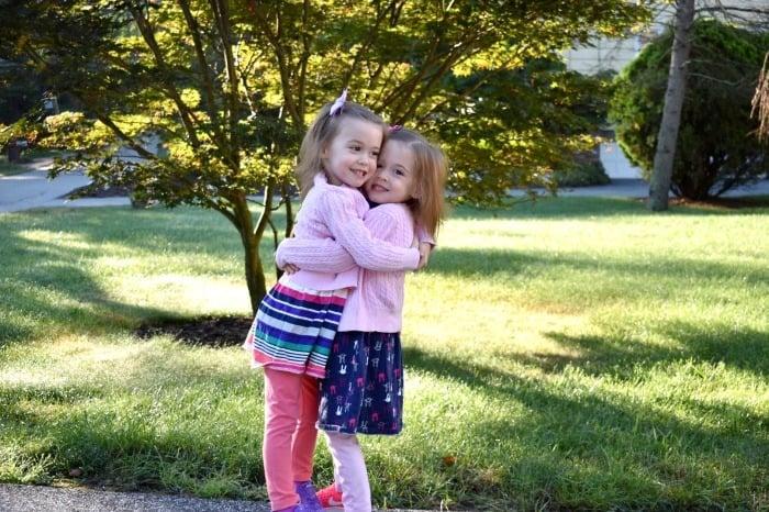 twin girls hugging preparing twins for kindergarten