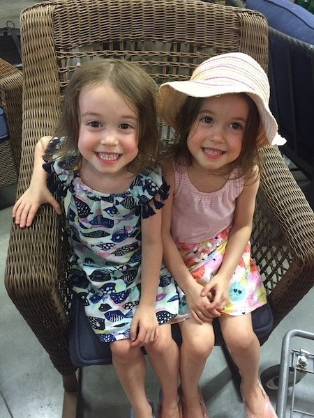 twin girls in a chair pros and cons of identical twins