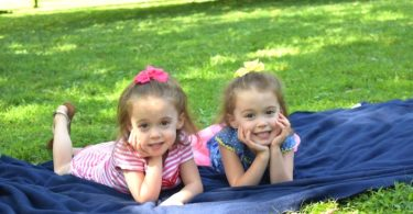 twin girls on a blanket pros and cons of identical twins